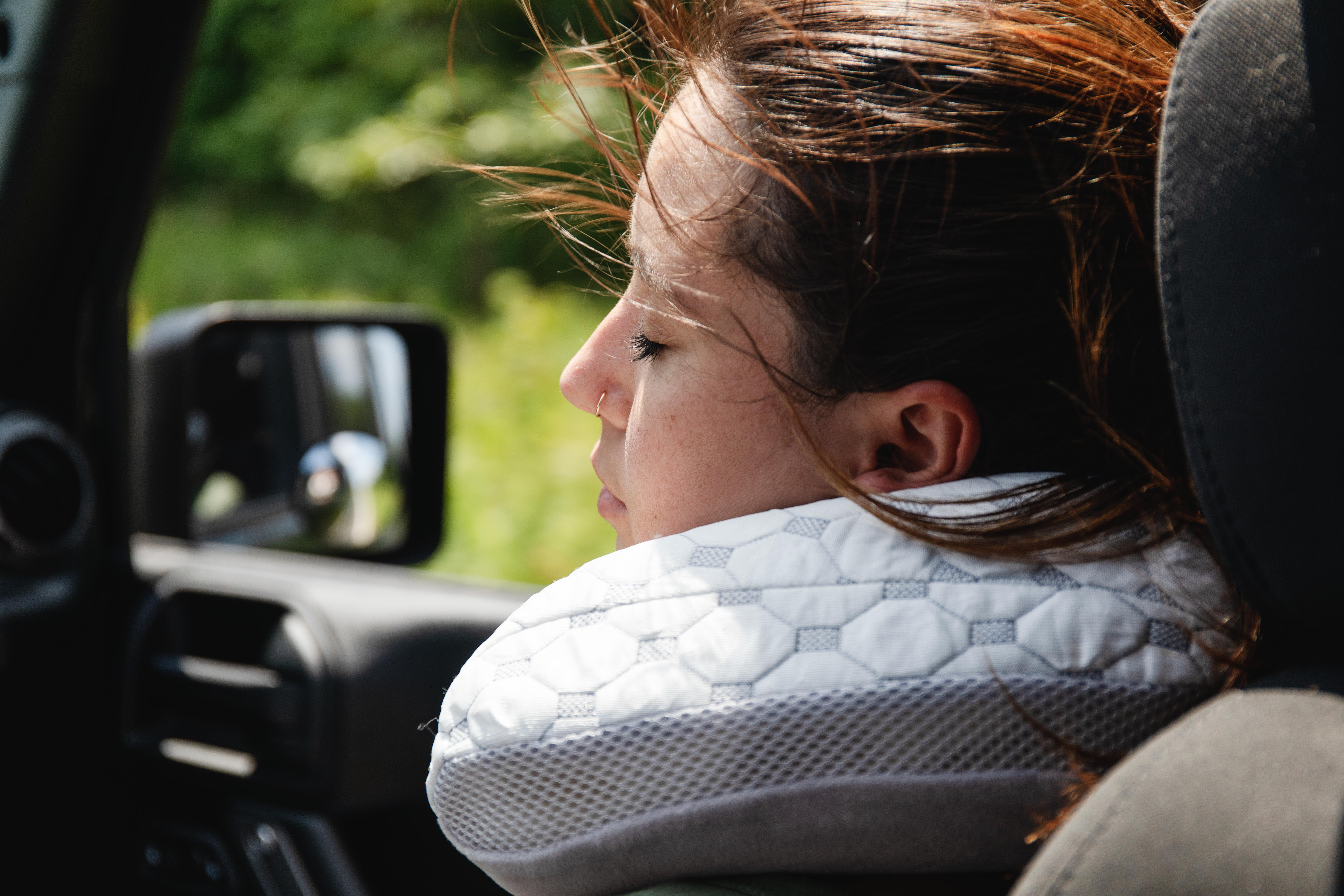 woman with muse travel pillow driving