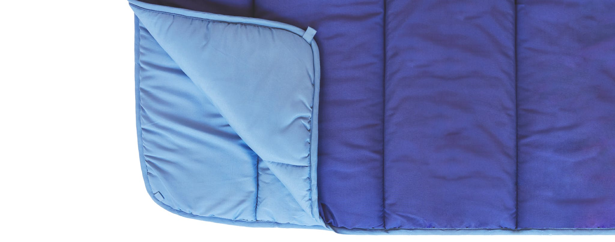blue comforter folded with corner peeled down