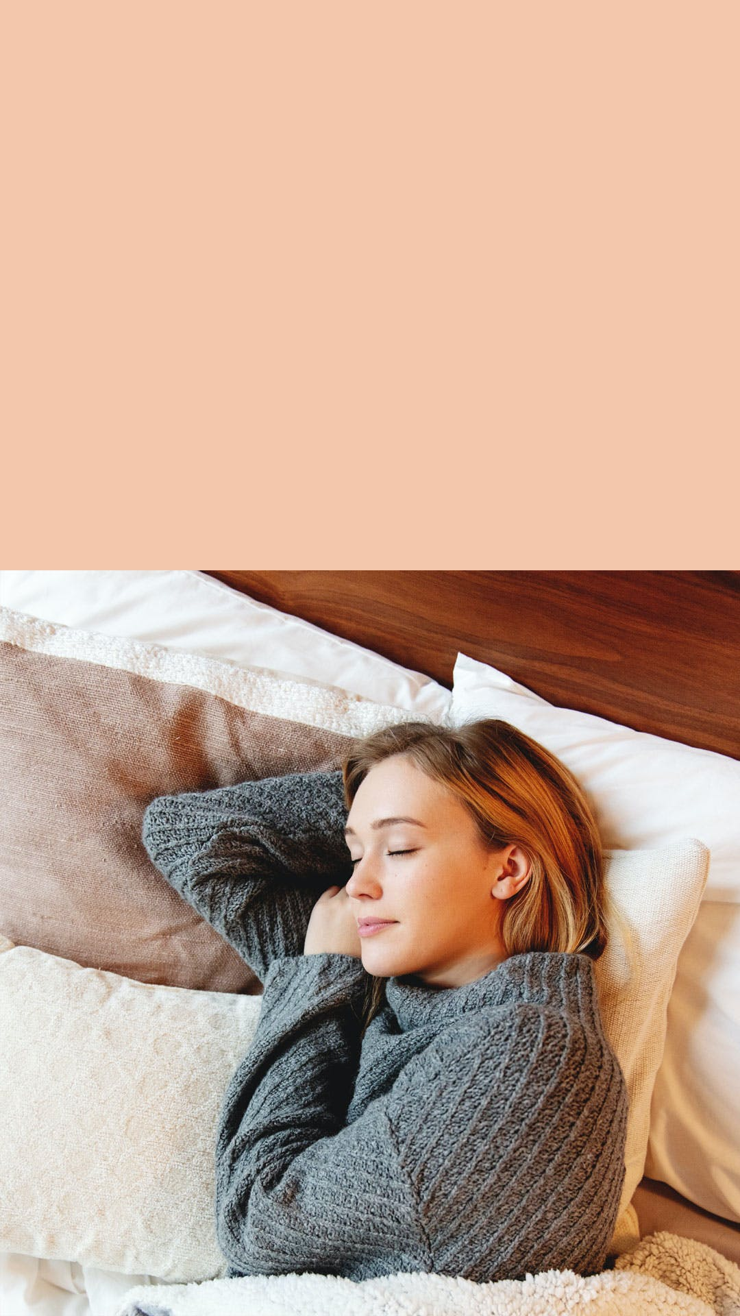 woman sleeps in a fall seasoned bed with beautiful blankets and pillows